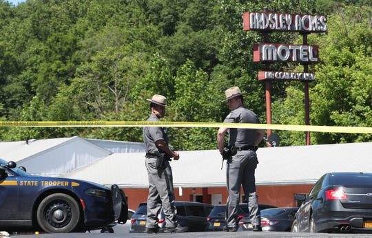 State police close off the entrance to the Ardsley Acres Motel on Saw Mill River Road in Ardsley June 4,  2019. An overnight drug raid left a suspect dead and two police officers wounded.