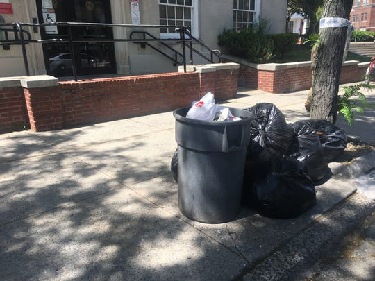 Garbage outside Mount Vernon City Hall on Tuesday, June 4, 2019, the second straight day without garbage pickup city wide due to unpaid bills for diesel fuel