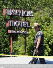 a New York State trooper stands at the entrance to the Ardsley Acres Motel on Saw Mill River Road in Ardsley June 4,  2019. An overnight drug raid left a suspect dead and two police officers wounded.