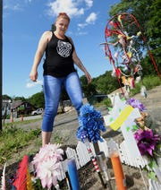 Chrystal Mackey visits the roadside memorial she set up where her brother, Richard Mackey, was killed on Rt. 17 in Sloatsburg June 4, 2019. Richard and his brother, Raymond, were hit while crossing the road on a riding lawnmower.
