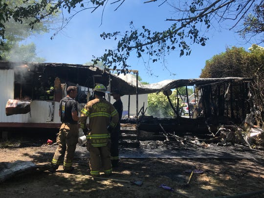 Two people were injured when a trailer burned in Rehoboth Beach Tuesday.