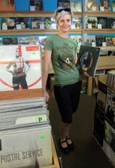 Rainbow Records co-owner Miranda Brewer at Rainbow Records in 2013 when she and her husband Todd bought the shop.