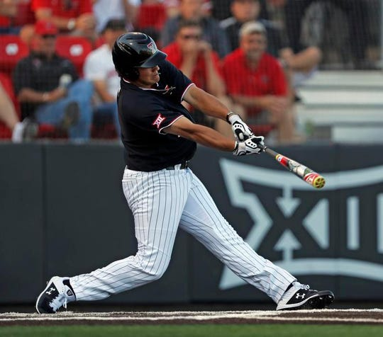 Texas Tech's Cameron Warren (11) hits a three-run home run during Sunday's NCAA college baseball regional game against Dallas Baptist.