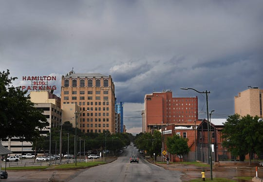 Rain falls on Wichita Falls Tuesday morning as thunderstorms move through the area.