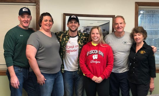 Manitowoc Minute host Charlie Berens visited Crave Brothers Farm to help kick off National Dairy Month. Pictured (from left) are Mark Crave, Beth Crave, Charlie Berens, Roseanne Crave, George Crave and Debbie Crave.