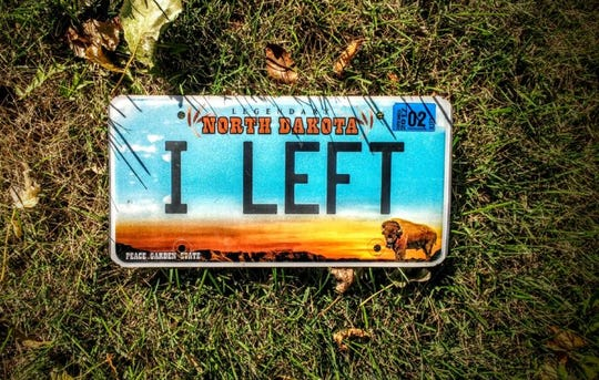 John Shrock's license plate is a reminder of the note he left his Amish family in Wisconsin to start a new life in North Dakota.