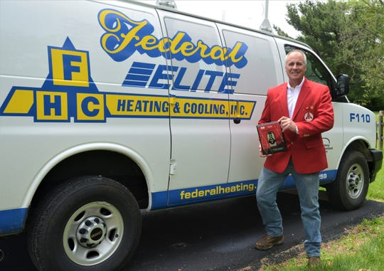 Steve Richards, founder and owner of Federal Elite Heating & Cooling, displays the Bryant Medal of Excellence and red jacket he received during the company's national banquet last month. FHC will be hosting a Grand Opening of its new facility in Frazeysburg next week.