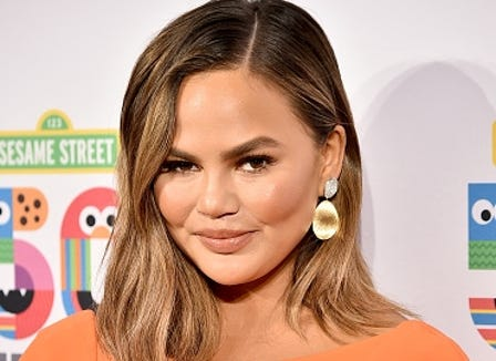 Chrissy Teigen struck back at an Instagram poster who judged her daughter's appearance.