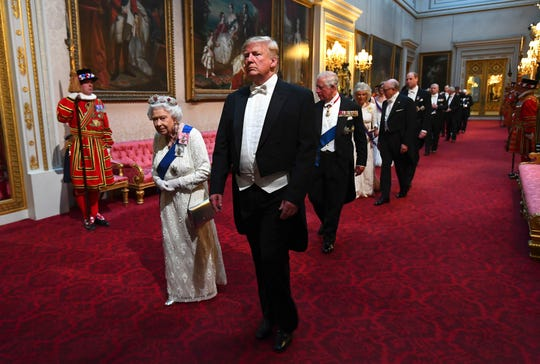 Queen Elizabeth II and President Donald Trump arrive through the East Gallery before a state banquet at Buckingham Palace on June 3.