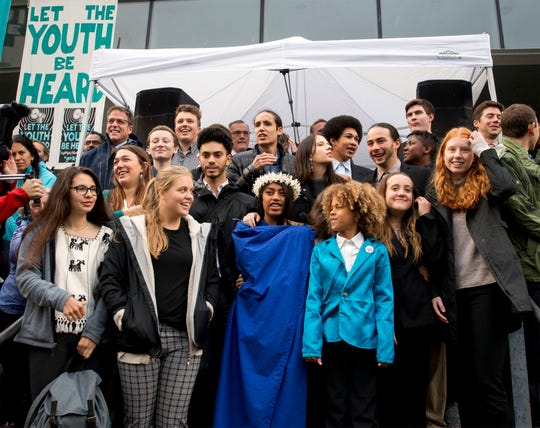 Young plaintiffs stand on the steps of the United States District Courthouse during a rally in Eugene, Ore., to support a high-profile climate change lawsuit against the federal government on Oct. 29, 2018.