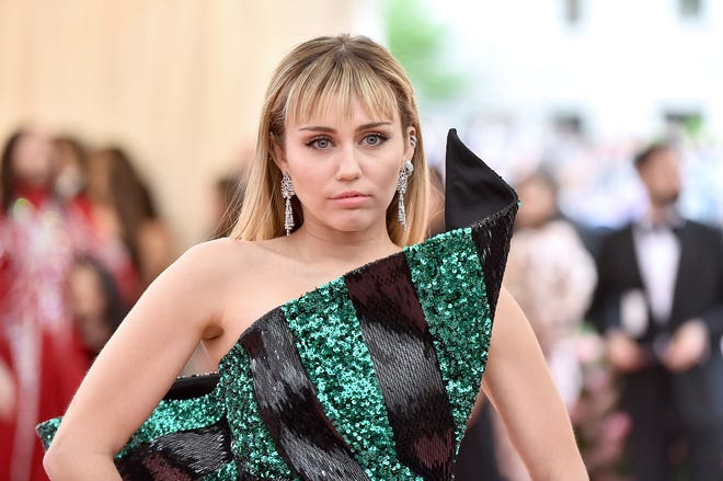 "Miley Cyrus ""just bein' Miley"" at the Met Gala on May 6, 2019 in New York City."