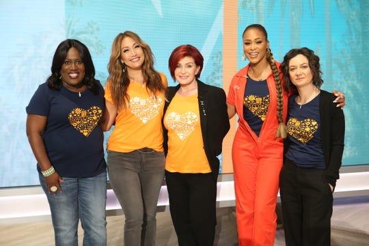 """The Talk"" co-hosts Sheryl Underwood, far left, Carrie Ann Inaba, Sharon Osbourne, Eve and Sara Gilbert."