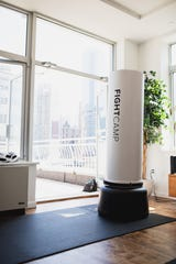 FightCamp's interactive kickboxing workout fits inside a small New York City studio apt. It can be adjusted to fit within 6' x 4' feet of living space.