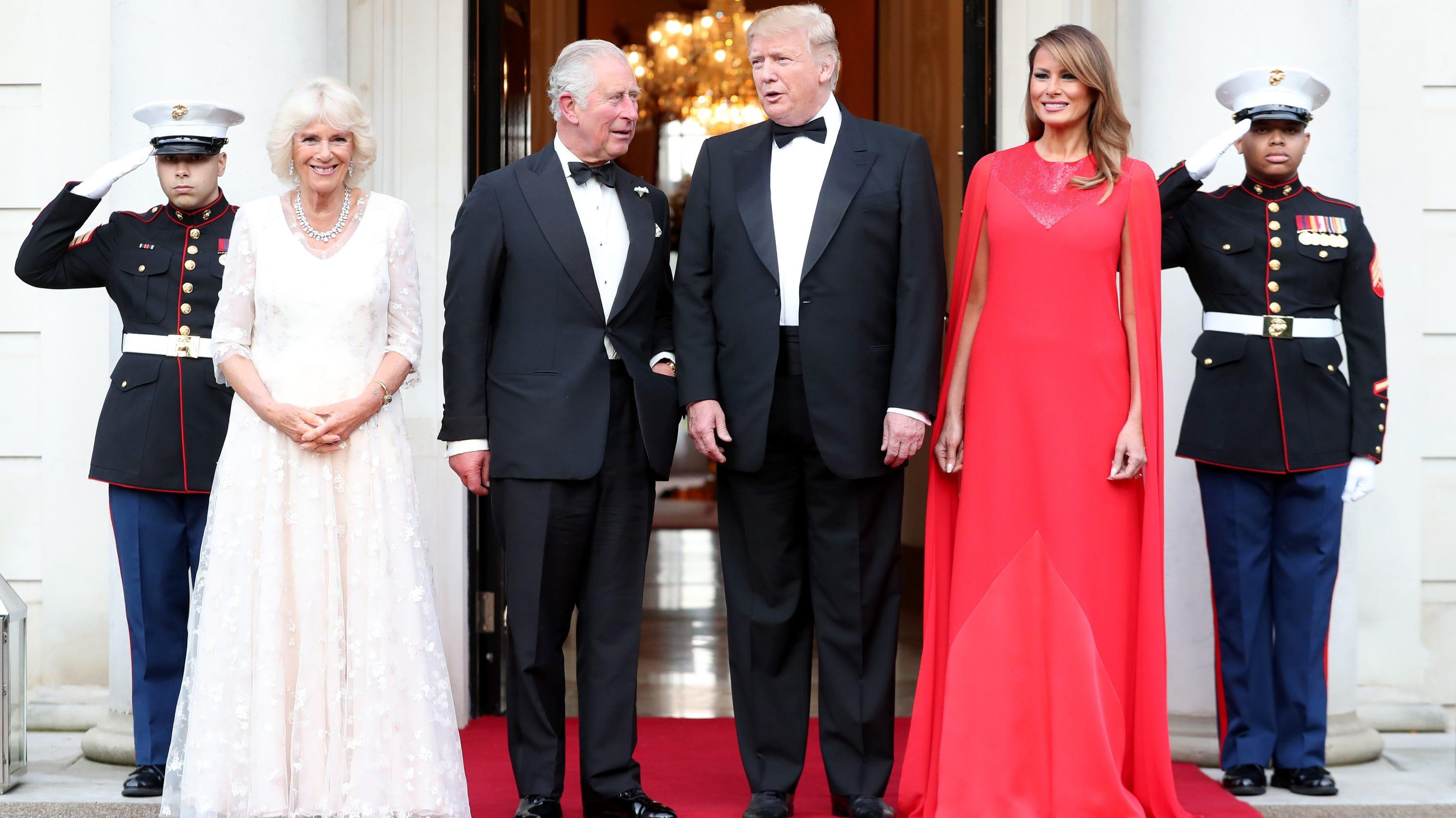 43cb8243dbbc Melania Trump wears red cape gown (by Meghan's wedding dress designer);  Trumps host royals