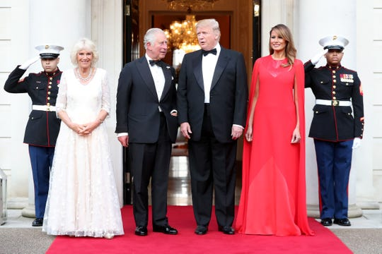 President Donald Trump and first lady Melania Trump host a dinner at Winfield House for Prince Charles and Camilla, Duchess of Cornwall, on June 4, 2019, in London.