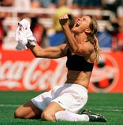 Brandi Chastain famously celebrates winning the World Cup in 1999, ripping off her jersey after converting in the clinching penalty kick.