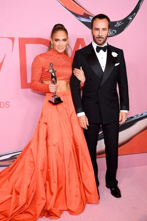 Jennifer Lopez poses with the Fashion Icon Award and Tom Ford during Winners Walk during the CFDA Fashion Awards at the Brooklyn Museum of Art on June 03, 2019 in New York City.