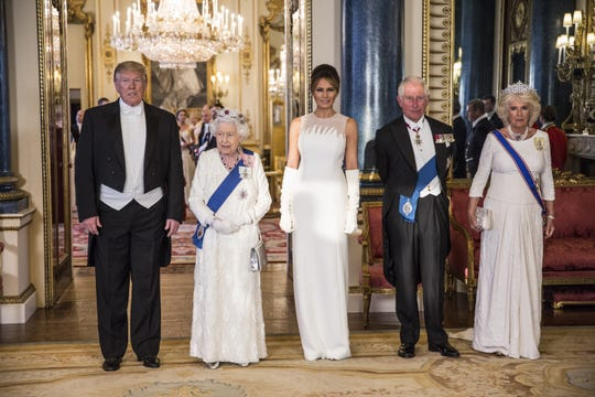 President Donald Trump, Queen Elizabeth II, first lady Melania Trump, Prince Charles and Camilla Duchess of Cornwall attend a State Banquet at Buckingham Palace on June 3, 2019. Melania Trump is wearing a Dior Haute Couture ivory silk crepe gown with silk tulle detail and over-the-elbow white gloves.