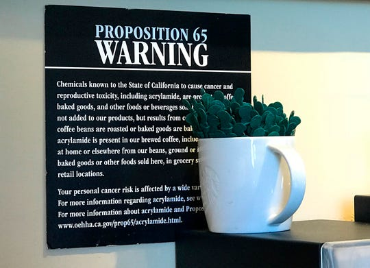 A Proposition 65 sign warns customers at a Starbucks coffee shop in Burbank, Calif.