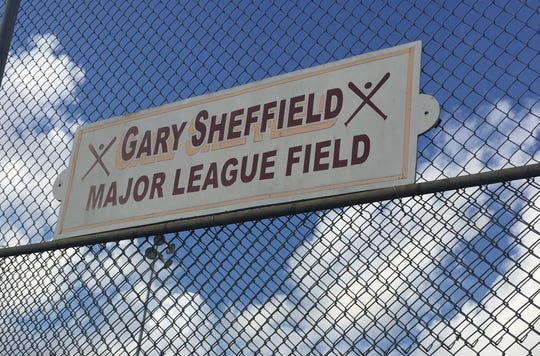A signs commemorating Gary Sheffield marks the entrances to the Belmont Heights Little League fields.
