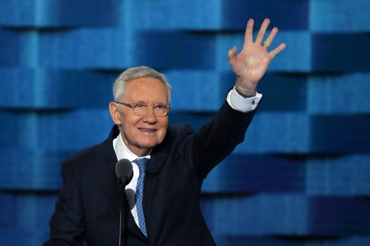 Then-Sen. Minority Leader Harry Reid, D-Nevada, waves to the crowd on the third day of the Democratic National Convention at the Wells Fargo Center on July 27, 2016 in Philadelphia, Pennsylvania.