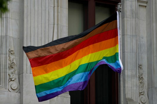 In this Monday, June 19, 2017, Philadelphia's altered gay pride flag is seen outside City Hall.