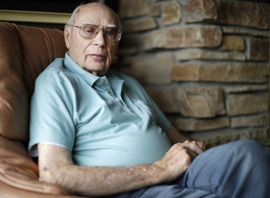Bill Faubel, 98, of Appleton, was stationed in England with the U.S. Army Air Forces 435th Troop Carrier Group during the D-Day invasion, sits for a portrait in his home Tuesday.