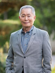 George Takei poses for a photo outside of his Los Angeles home in 2017.