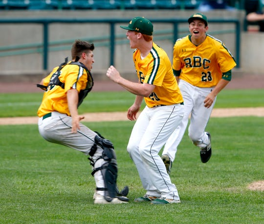 Red Bank Catholic pitcher Shane Panzini celebrates after throwing the final strike against Manalapan with teammates Chris Sparber (left) and Robert Gonzalez to win the Shore Conference Baseball Tournament championship at First Energy Park in Lakewood Wednesday, June 5, 2019.