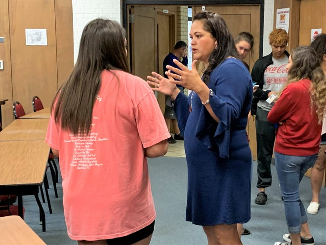 New Cooper girls soccer coach Michelle Velez, right, talks to a returning player during a meet and greet on Wednesday morning at CHS. Velez comes to the Lady Cougars after three years at Craig Middle following nine years at Abilene High.