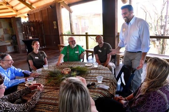New Abilene Zoo Director Jesse Pottebaum speaks with guests at the zoo's giraffe terrace June 4.
