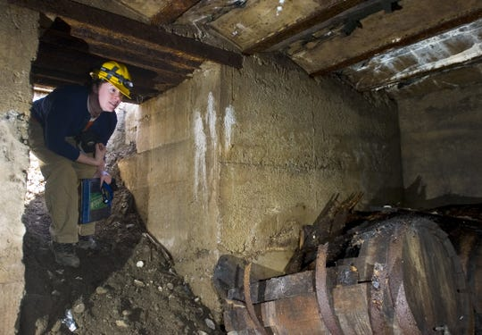 2007: Shannon Glaser, a project director with  Binghamton University's Public Archaeology Facility,  enters the hidden rooms believed to be from the Prohibition era, found under the parking lot of Cafe West on Main Street in Binghamton. The archaeologists are documenting the discovery of the rooms that were found when repairs were being made to the parking lot.