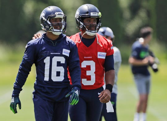 Seattle Seahawks quarterback Russell Wilson (3) walks off the field with wide receiver Tyler Lockett (16) following an organized team activity Tuesday, June 4, 2019, at the team's NFL football training facility in Renton.