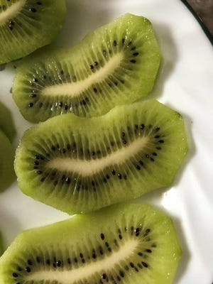 """Next time you purchase a package of kiwi fruit, watch fora package where the fruit is slightly abnormal or elongated. Then you can slice them into """"kiwi smiles."""""""