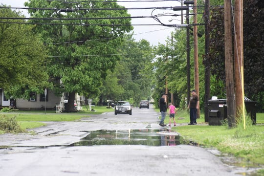 Galion residents survey storm damage Wednesday evening.