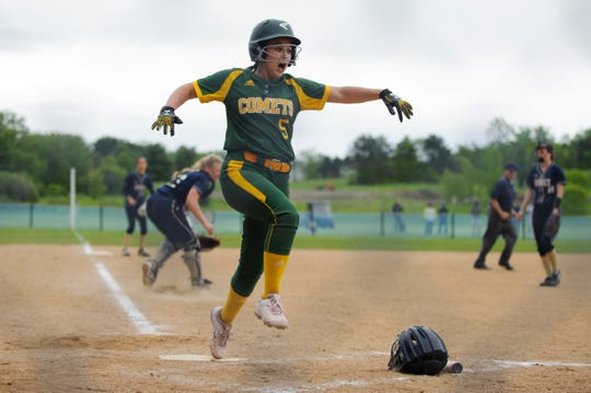 BFA's Avery Daudelin (5) crosses home plate for a run during the Division I softball semifinal game between the BFA St. Albans Comets and the Essex Hornets at Essex High School on Tuesday. afternoon June 4, 2019.