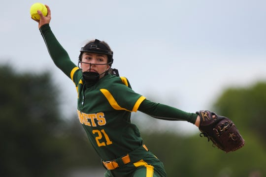 BFA's May Gratton (21) delivers a pitch during the Division I softball semifinal game between the BFA St. Albans Comets and the Essex Hornets at Essex High School on Tuesday. afternoon June 4, 2019.