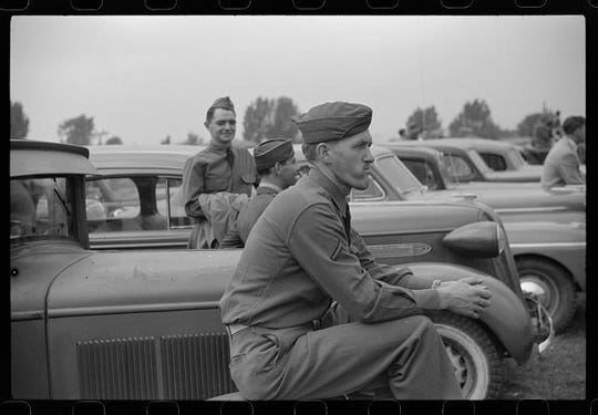 Soldiers attend the Champlain Valley Exposition in Essex Junction. Based on the date, they presumably served during the second World War. Photograph created/published August 1941. Jack Delano.