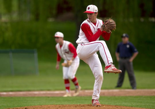 Champlain Valley lefty Ian Parent winds up for a pitch in the first inning during a Division I high school baseball semifinal game in Hinesburg on Tuesday, June 4, 2019.