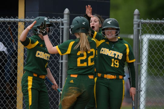 BFA celebrates a run during the Division I softball semifinal game between the BFA St. Albans Comets and the Essex Hornets at Essex High School on Tuesday. afternoon June 4, 2019.