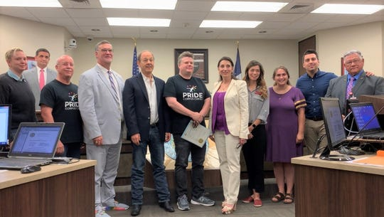 Members of The Mosaic Project of South Texas pose with Nueces County Judge Barbara Canales after she presented them with a county judge's proclamation on June 5, 2019 recognizing Pride Week in Corpus Christi.
