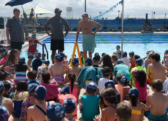 From left to right: Josh Davis, Cullen Jones and Rowdy Gaines prepare to teach swim lessons and water safety at the Make a Splash event, Wednesday, June 5, 2019, at the Portland Aquatics Center. The event is in hopes of promoting swimming and water safety.