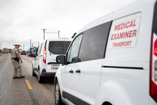 The medical examiners office arrives as law enforcement investigate a fatal wreck that left six migrants dead and several others injured outside Robstown, Texas on Wednesday, June 5, 2019