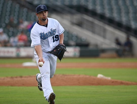 Hooks pitcher Brandon Bailey tosses a ball to first against the Midland RockHounds in a Texas League Series, Tuesday, June 4, 2019, at Whataburger Field.