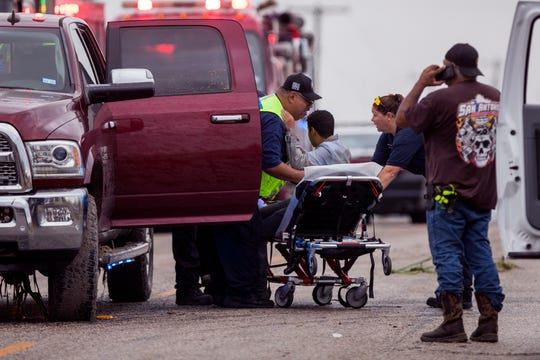 A chase by the Robstown Police Department of about 14 people in a suburban Tuesday night ended with the discovery of a wreck early Wednesday that left six migrants dead, five injured and two in the custody of Border Patrol just outside of Robstown, TX. Multiple agencies responded to the scene Wednesday, June 5, 2019, to help transport injured people, including this man, and scour the area to make sure everyone had been accounted for.