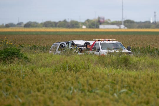 Law enforcement move the vehicle as they investigate a fate wreck that left six migrants dead and several others injured outside Robstown, Texas on Wednesday, June 5, 2019.