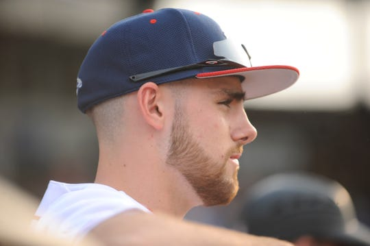 Cody Orr watches game in a 2-1 loss to Terre Haute on June 4. Orr has dominated on the mound and at the plate for the Paints so far this season.