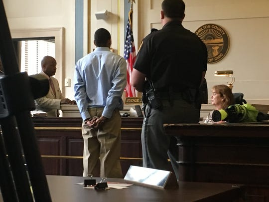 Jamall Killings, his hands shackled behind his back, stands before Hamilton County Common Pleas Judge Patrick Foley on Wednesday, June 5, 2019. Killings pleaded guilty to felonious assault and Foley sentenced him to 24 months in prison. Because Killings has already served 792 days in jail awaiting trial, he will be released. He will be monitored by authorities for the next three years.