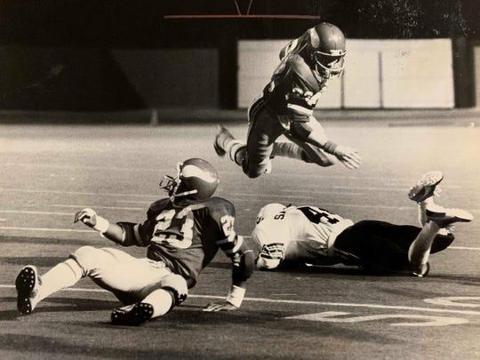 Princeton's Ken Roundtree vaults a Sandusky would-be tackler Nov. 1, 1978. Vicking back Leroy Stenson is at left.