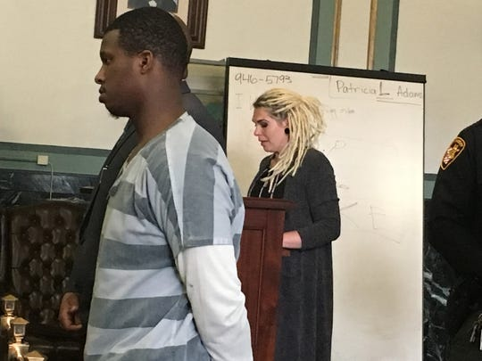 Ke'von Smith, at left, listens as Amber Caudell, the mother of the 9-year-old girl he killed, reads a statement during his sentencing Wednesday in Hamilton County Common Pleas Court. Sylvia Hendon, a visiting judge, sentenced Smith to 18 years in prison. He pleaded guilty Monday to voluntary manslaughter in the 2017 fatal shooting of Alexandrea Thompson.